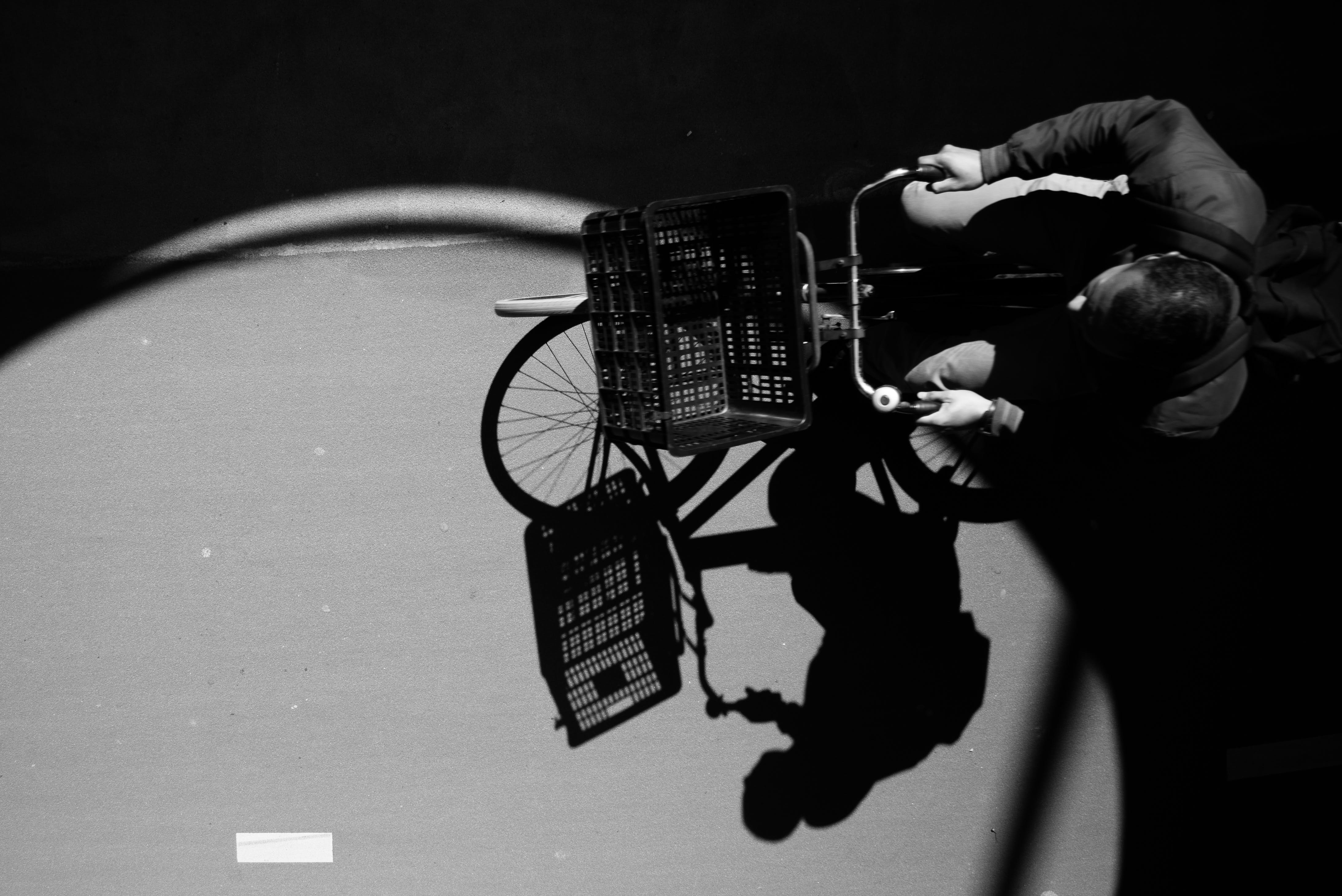 Gray Scale Photo Ofman on City Bike