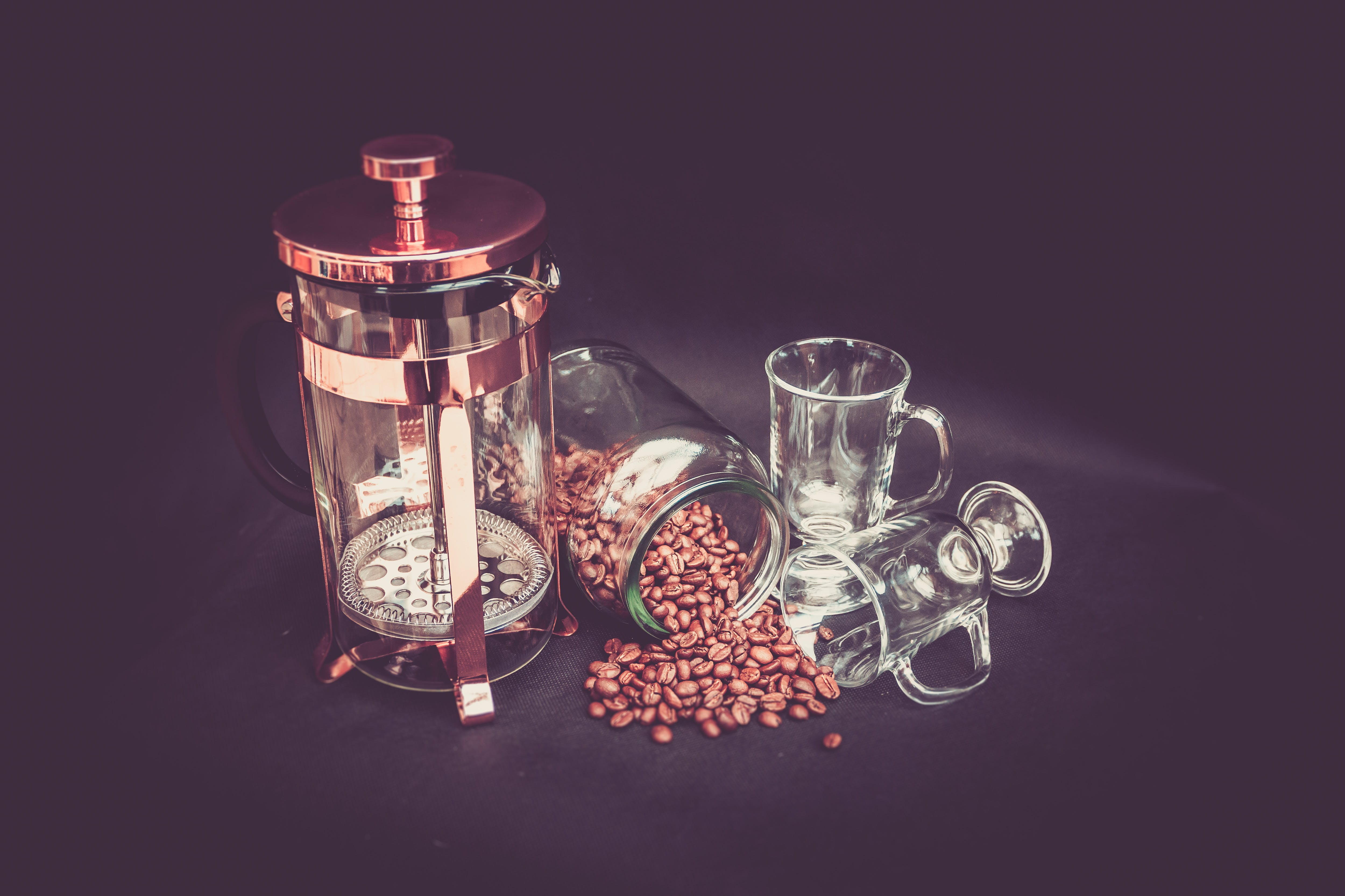 Photograhy of Brown Beans, Clear Glass Mug, and Brass Coffee Grinder