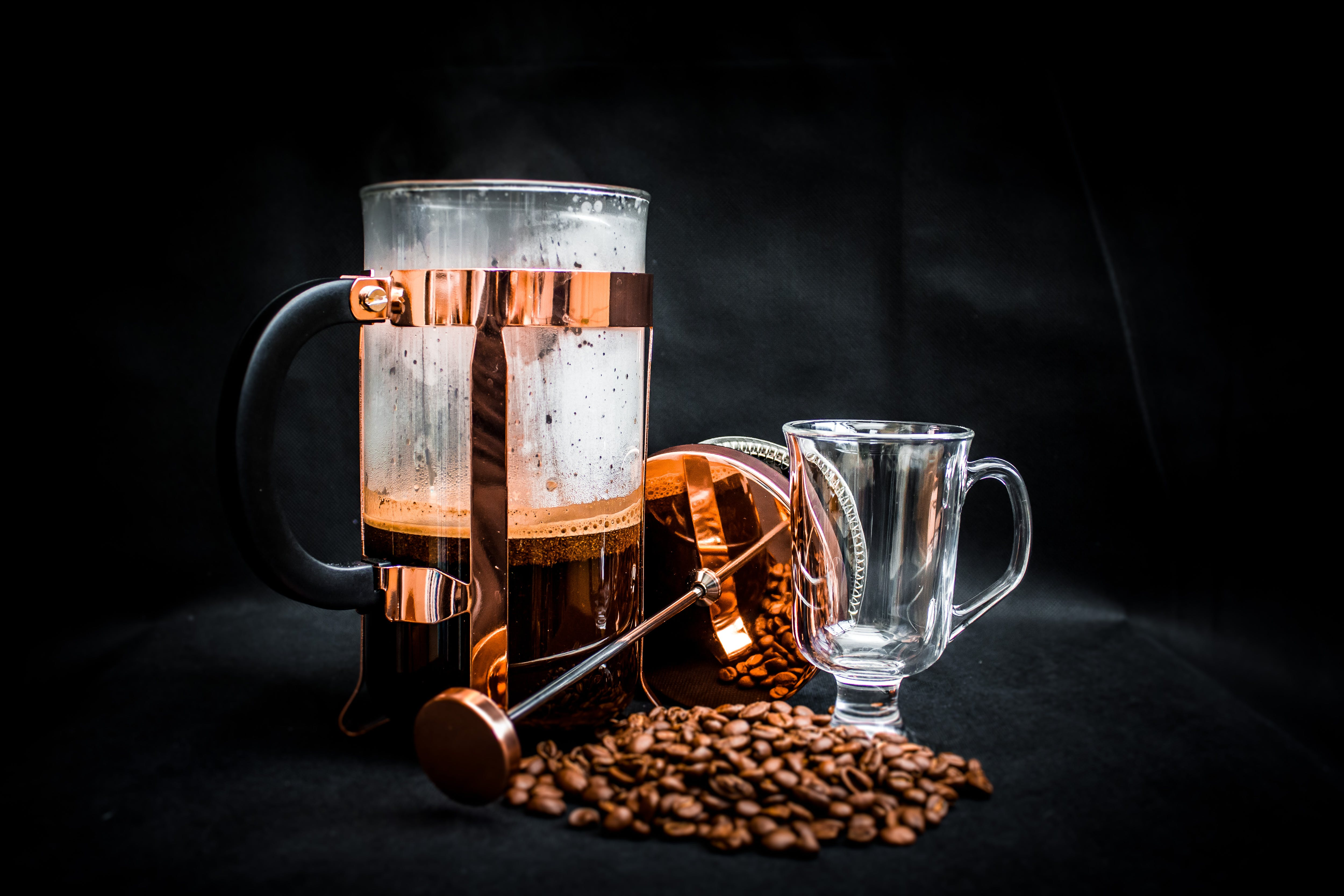Coffee Beans Beside Coffee Press and Glass Cup