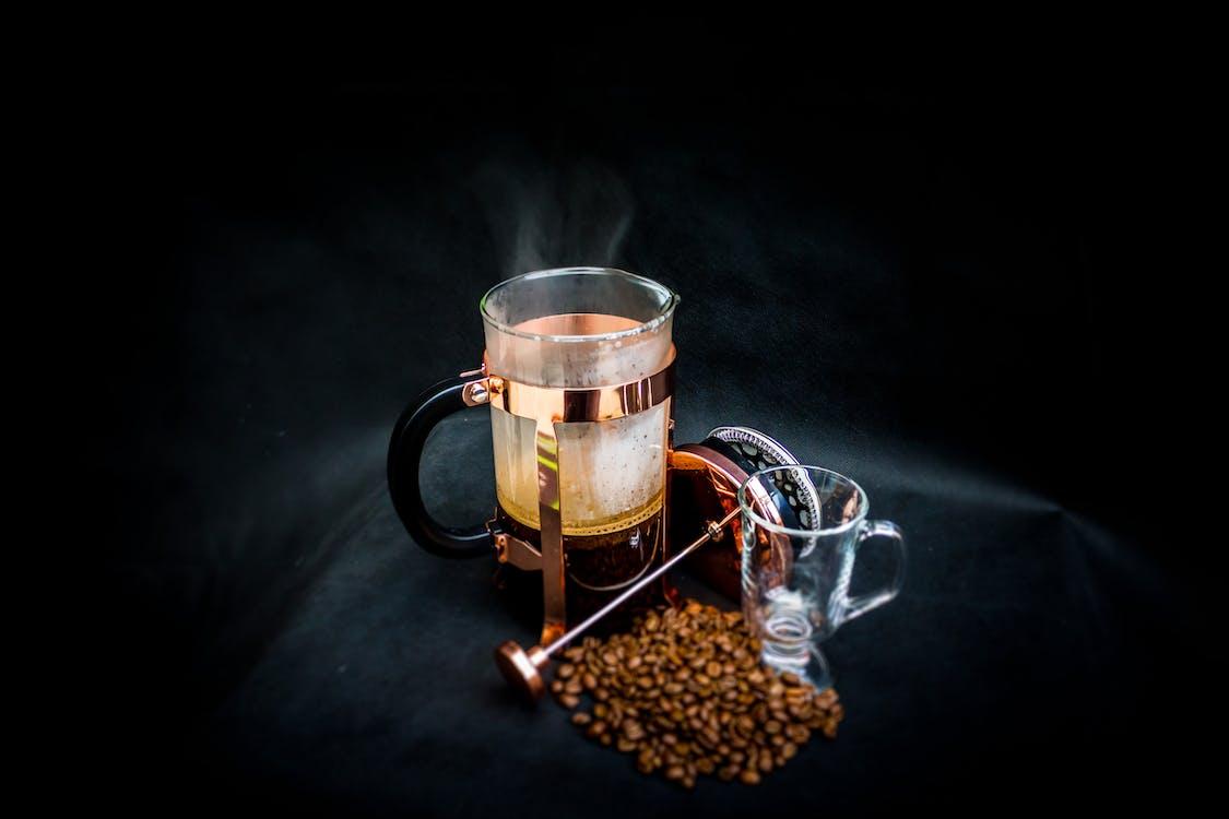 Photo of Open Coffee Press Beside Glass