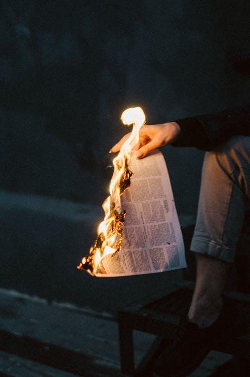 Man in Black Long Sleeve Shirt Holding Fire