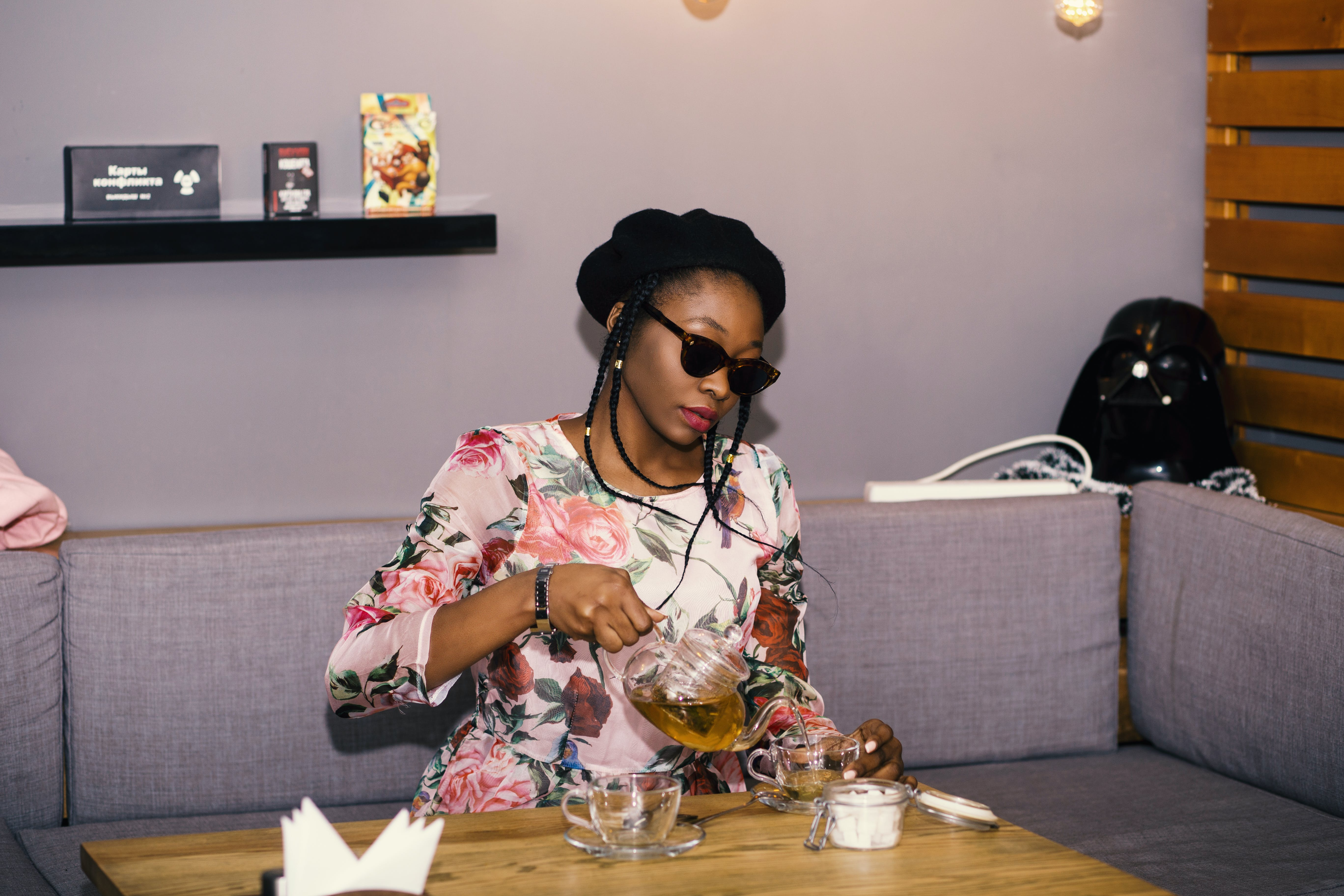 Woman Pouring Tea on Cup