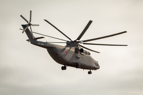 A Military Helicopter Flying in the Sky