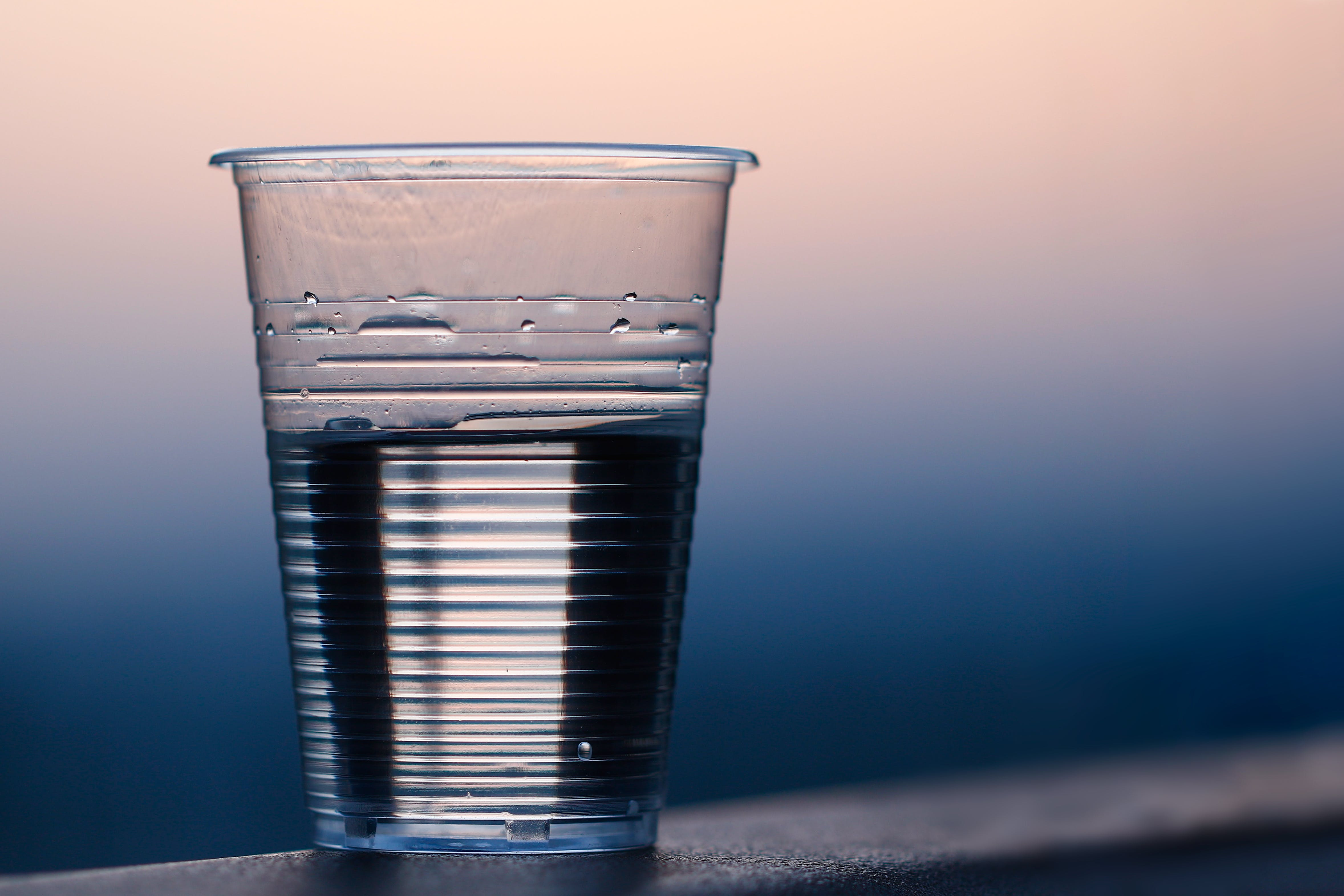 Clear Plastic Cup on Gray Surface