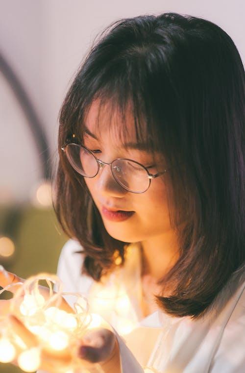 Woman in White Shirt Wearing Black Framed Eyeglasses