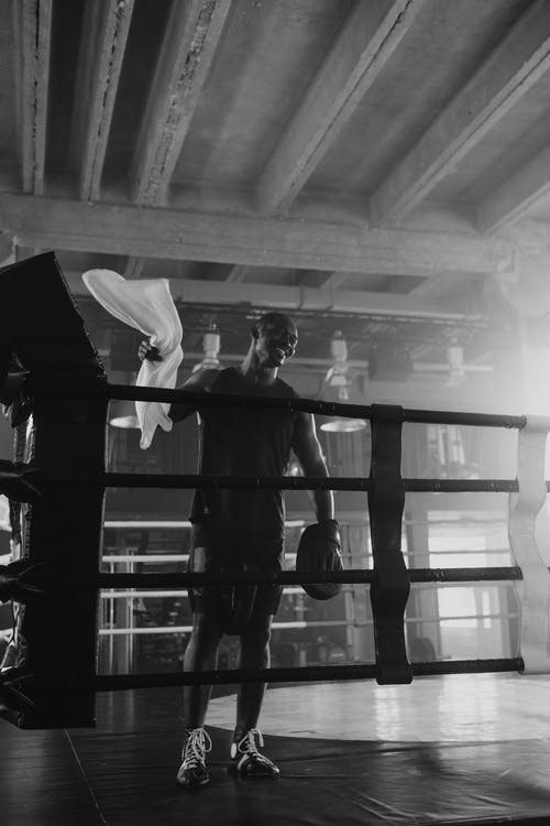 Man Inside the Boxing Ring Holding a Towel