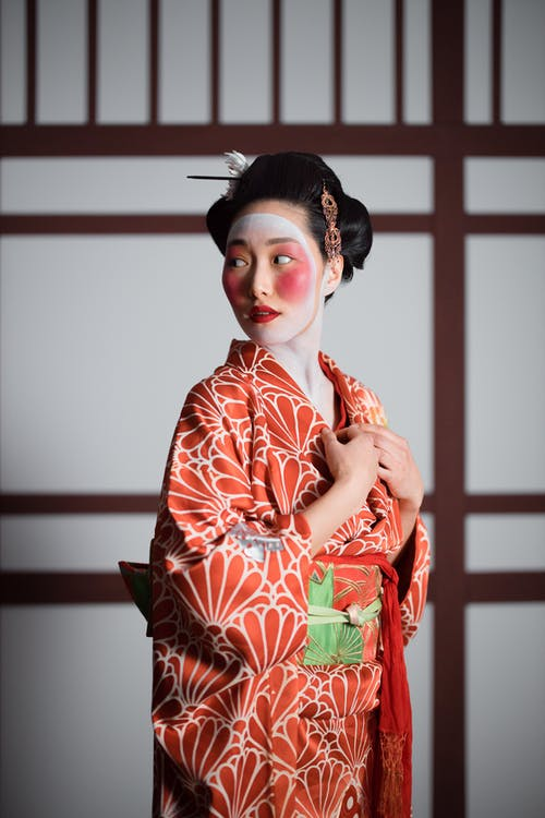 Woman in Red and White Floral Kimono