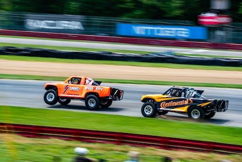 Orange and Black F 1 Car on Track