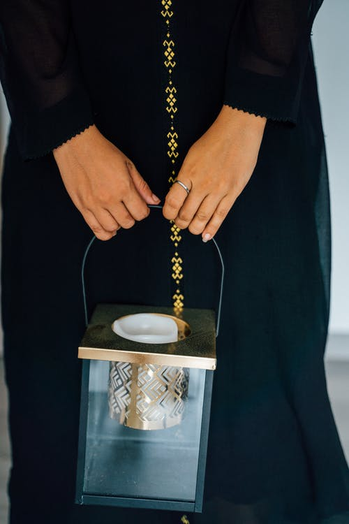 Close-Up Shot of a Person Holding a Lantern