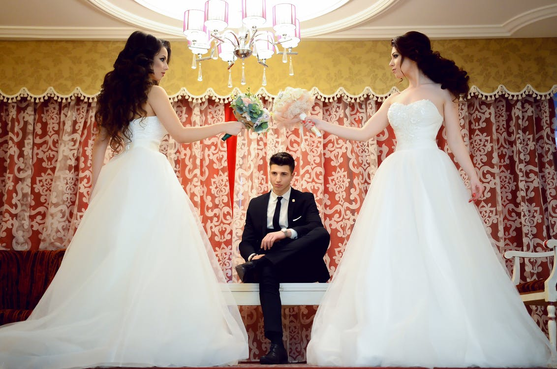 Woman Wearing White Strapless Wedding Dress