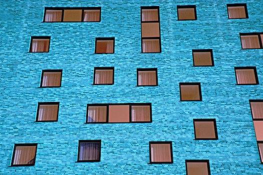 Kostenloses Stock Foto zu blau, gebäude, ziegel, mauer