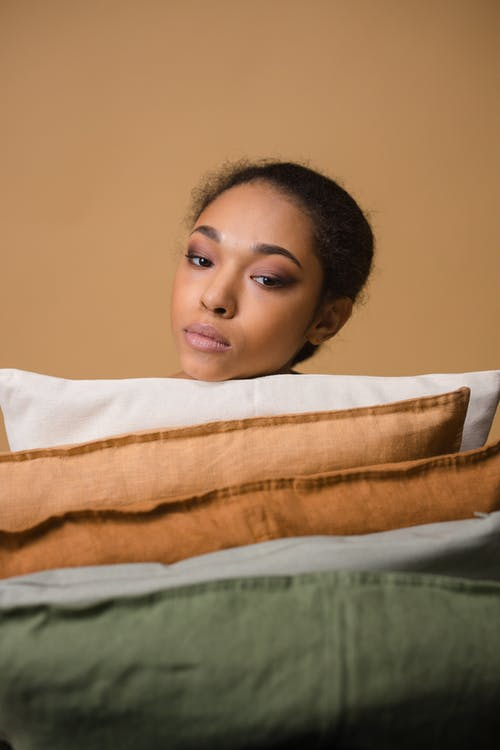 Woman Leaning Her Head On Throw Pillow