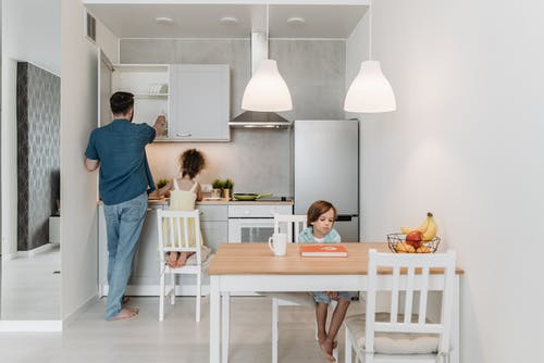 Man in the Kitchen with his Children