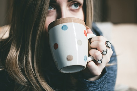 Woman Holding Her Multicolored Polka-dot Ceramic Mug