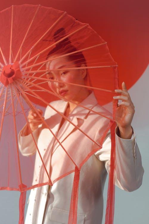 Woman In White Blazer With An Umbrella
