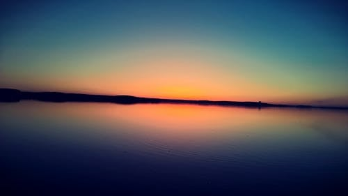 Sunset on Body of Water