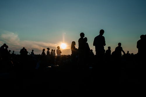 Silhouette of People Standing during a Sunset