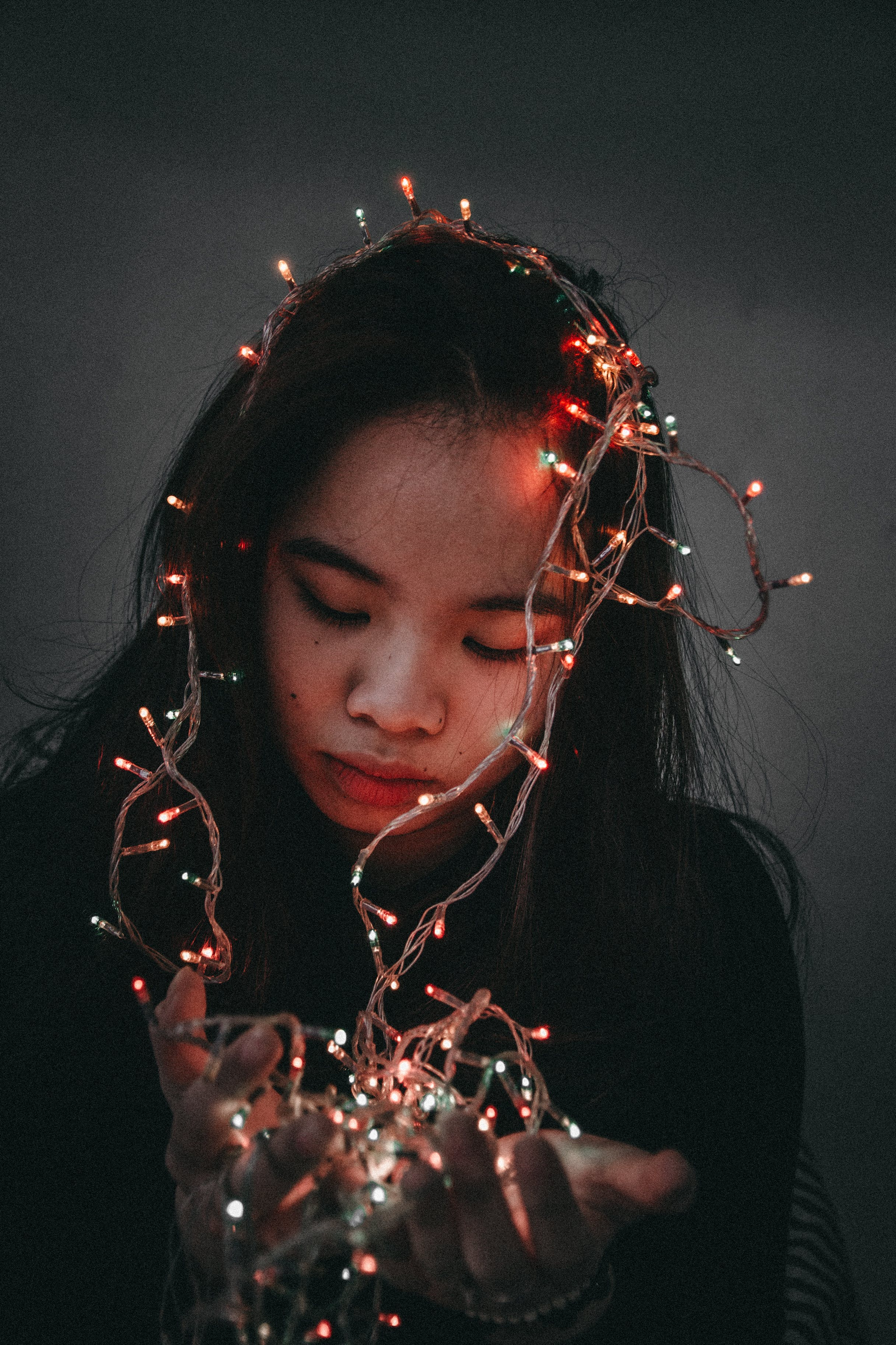 Woman Wears Black Long-sleeved Shirt Hold String Lights