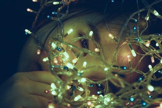 Girl Facing Turned on String Light