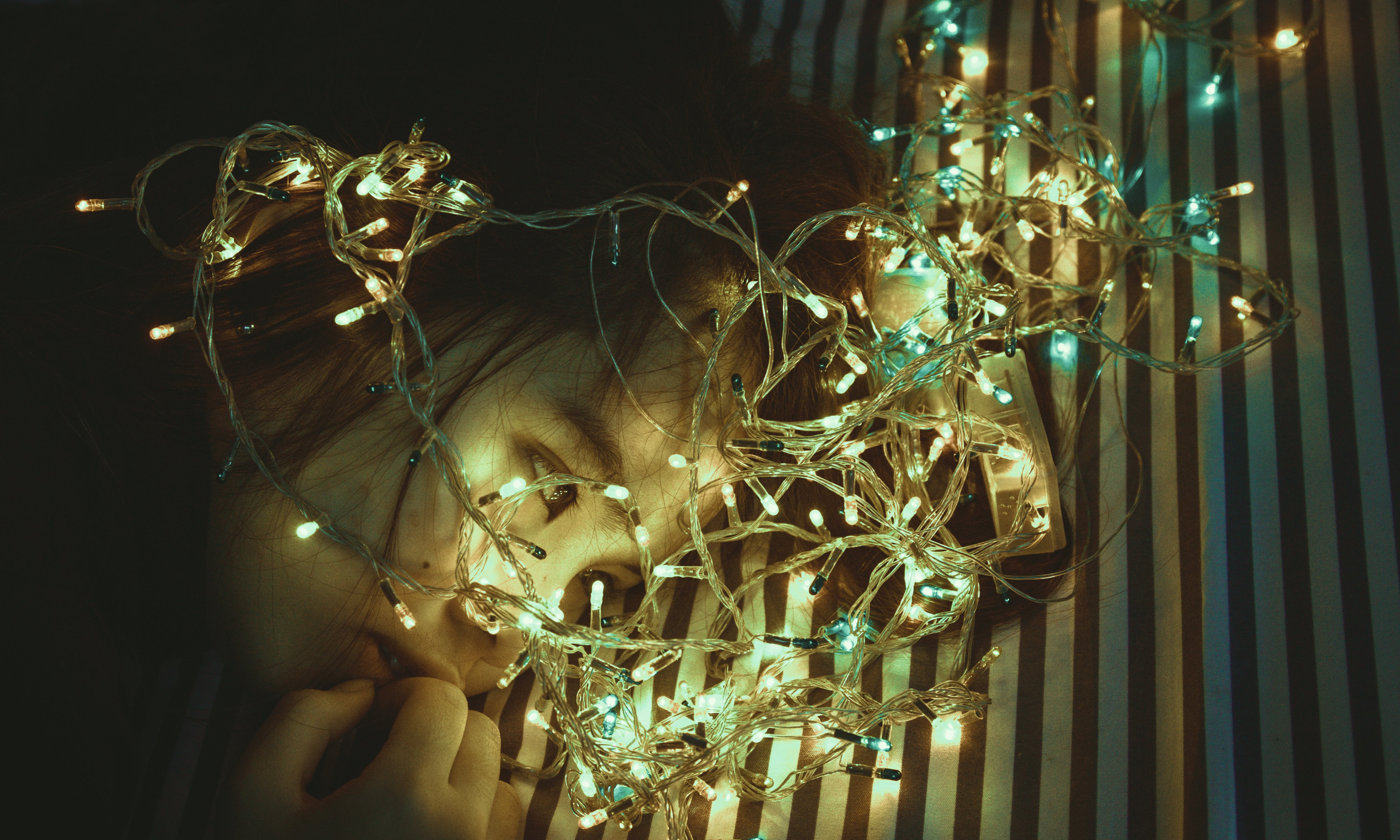 Woman Near Assorted-color String Lights