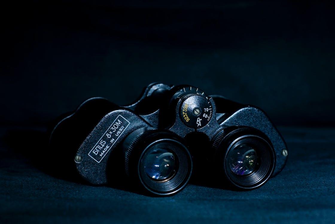 Black Binoculars on Black Pad