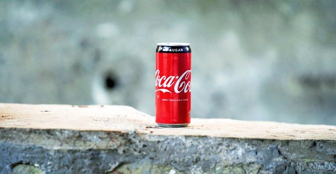 Coca-cola Can on Brown Concrete Surface