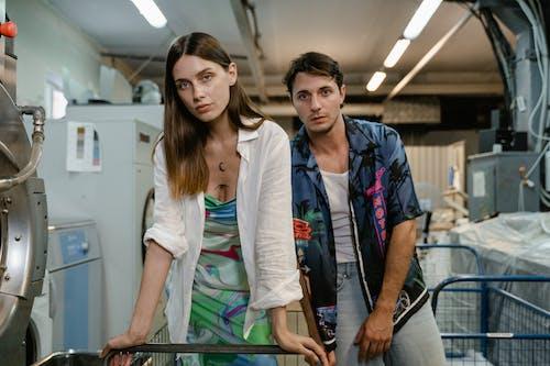Woman in White Blazer Standing Beside Woman in Blue Blazer