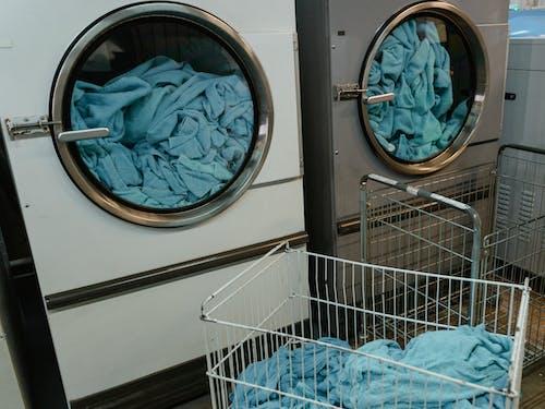 Blue Textile on White Metal Shopping Cart
