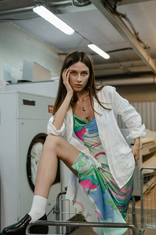 Woman in White Blazer and Green Pink and Yellow Floral Dress