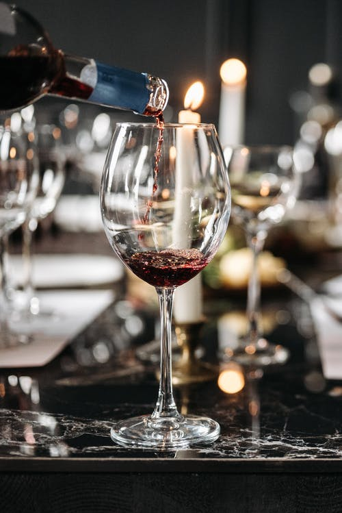 Close-Up Shot of a Red Wine on a Dining Table