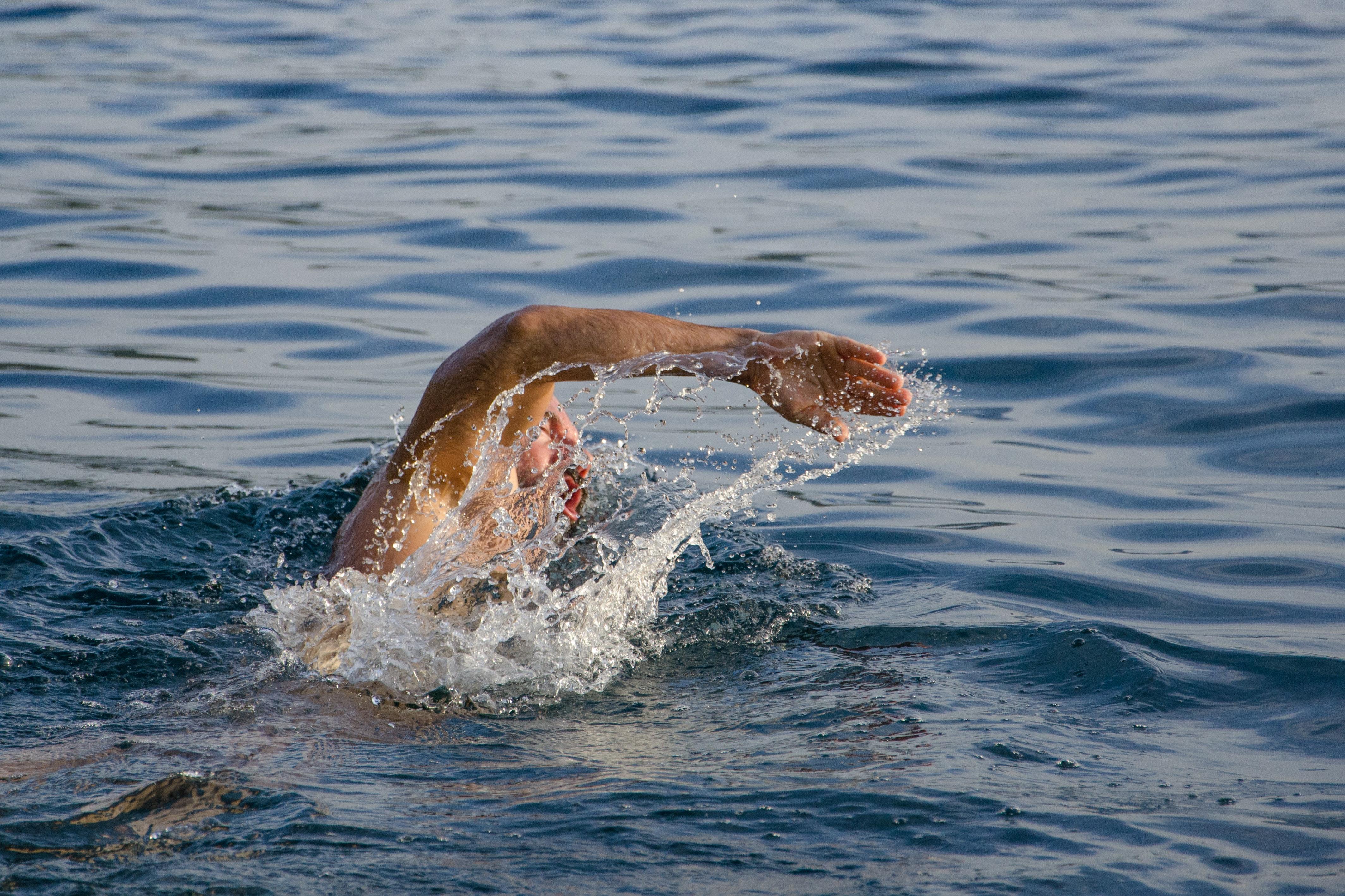 naked black man swimming