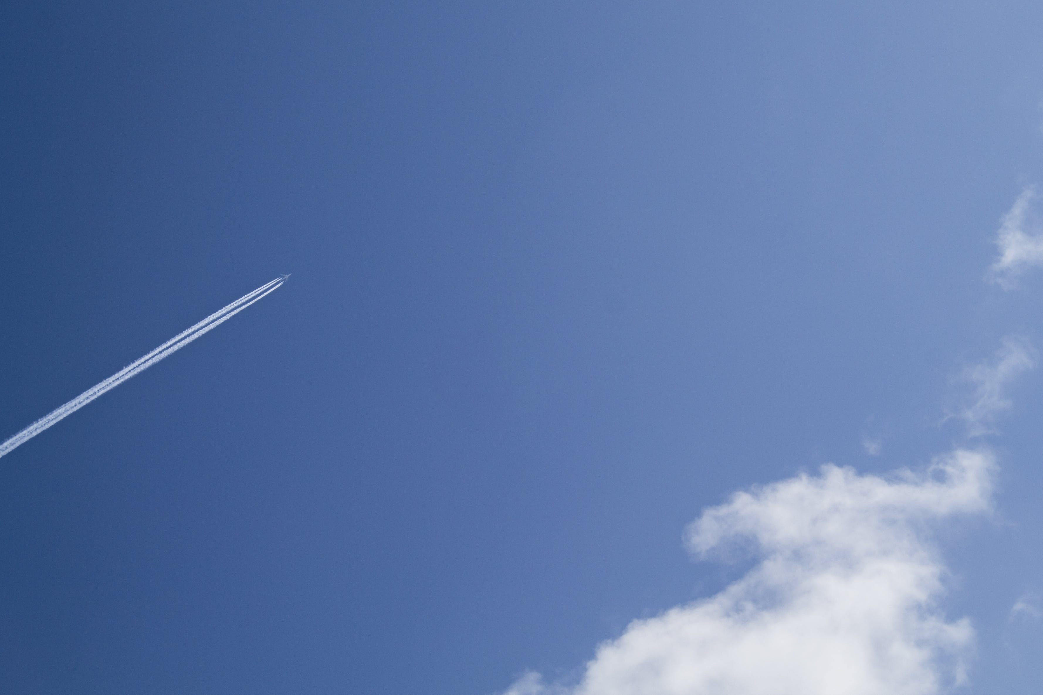 Jet Under Clear Blue Sky during Daytime