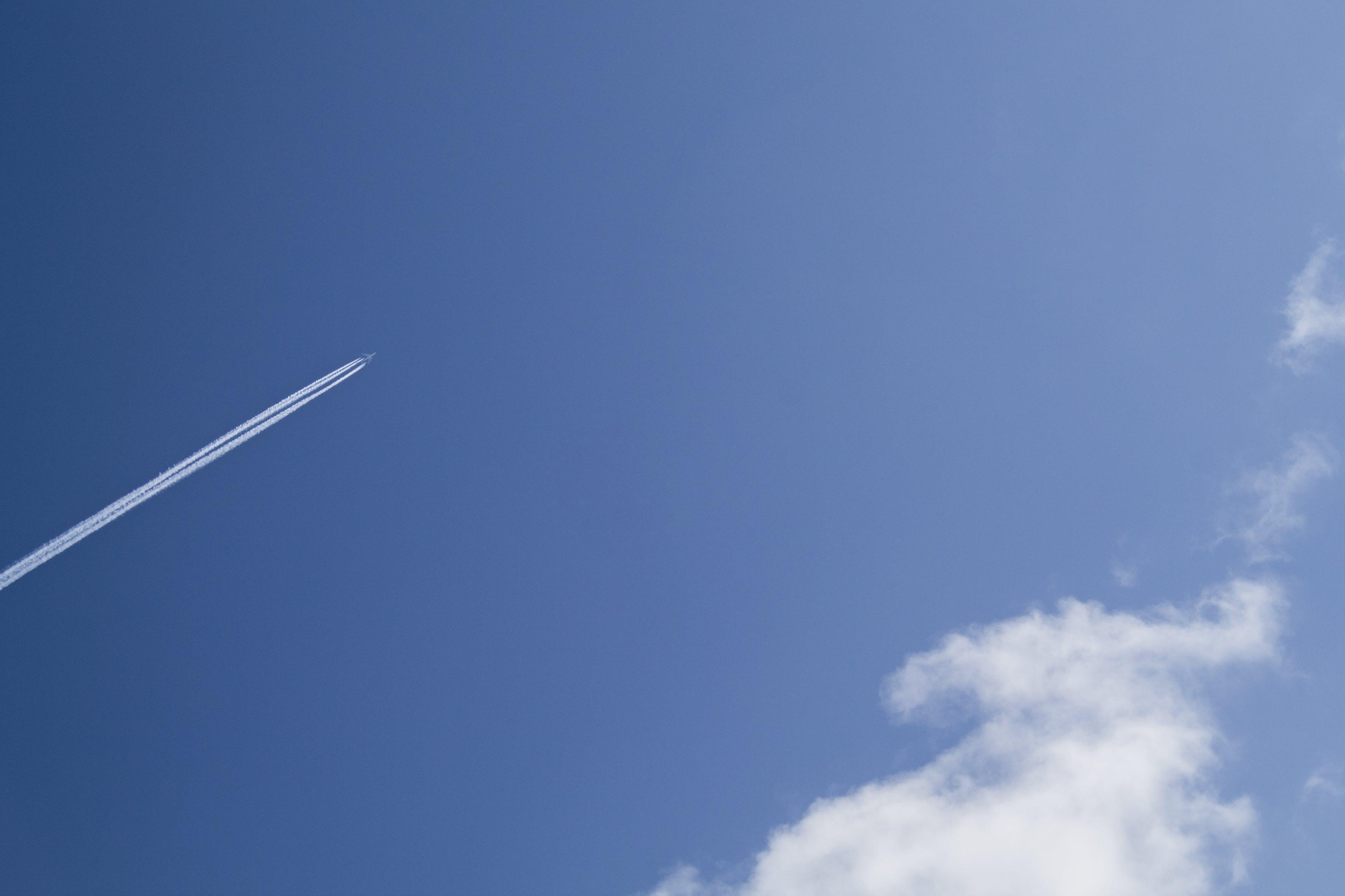 Jet Under Clear Blue Sky during Daytime
