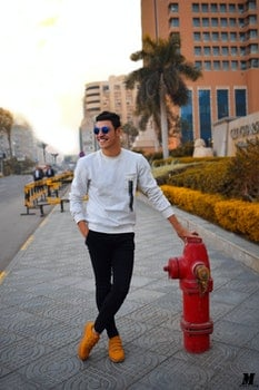 Man in White Long-sleeved Shirt Holding Red Fire Hydrant