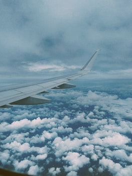Airplane Wing and Thick Clouds