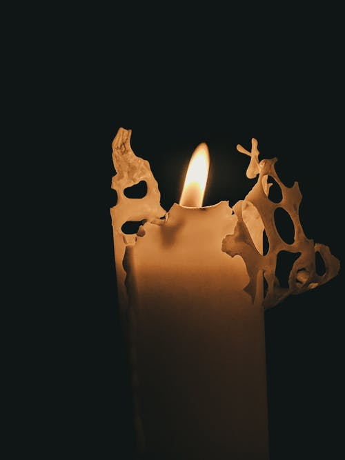 White Candle With Fire in Black Background