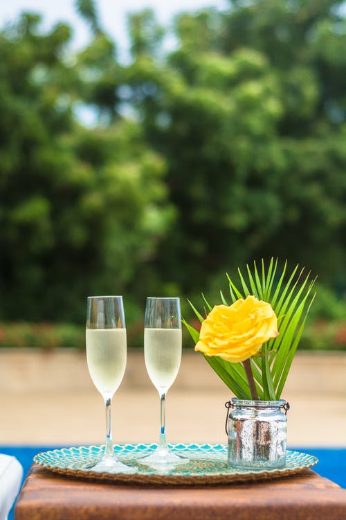 Yellow Rose Flower Centerpiece and Two Clear Champagne Flutes