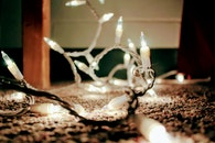 Close Up Photo of White and Black String Lights