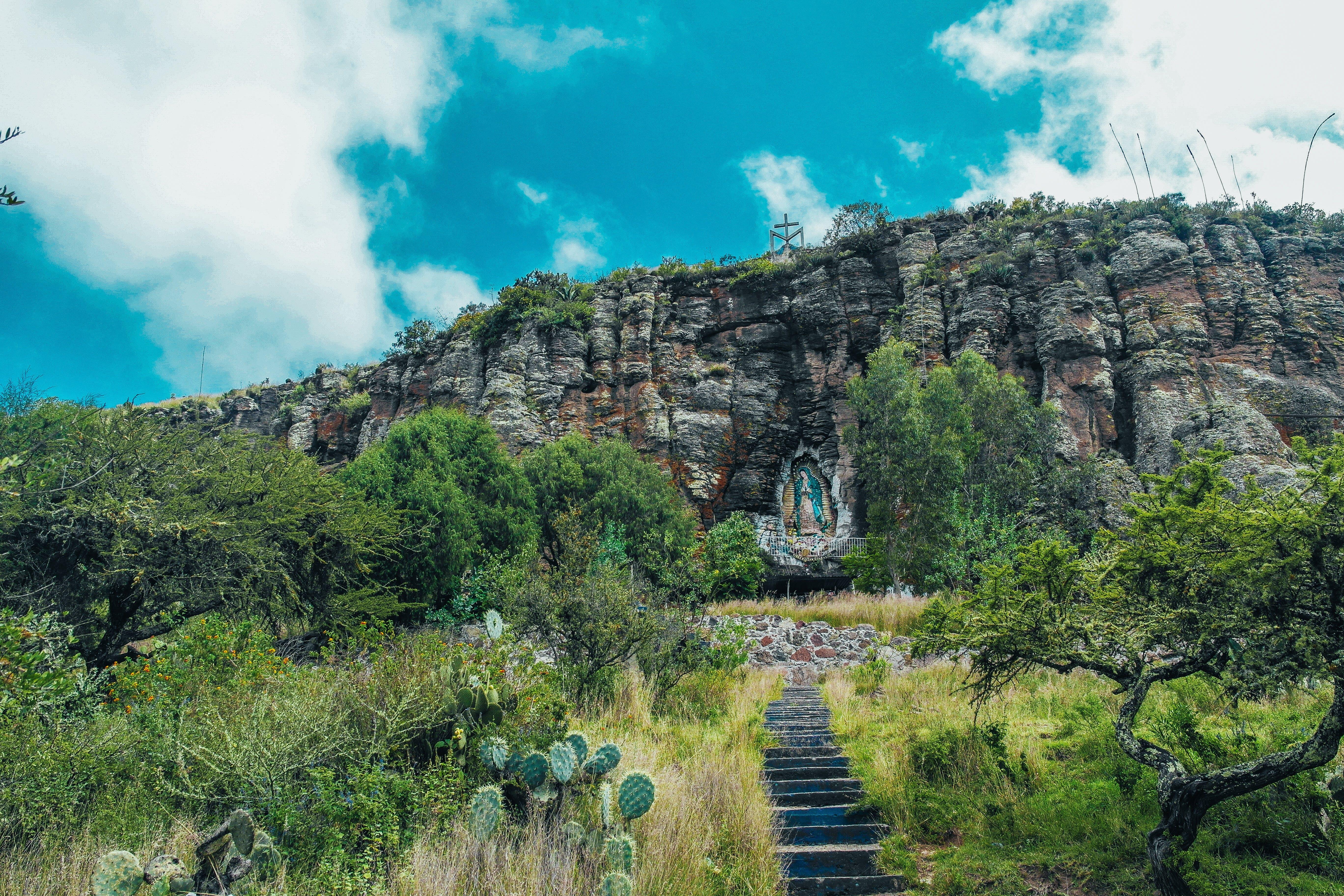 Black Concrete Staircase and Massive Mountain