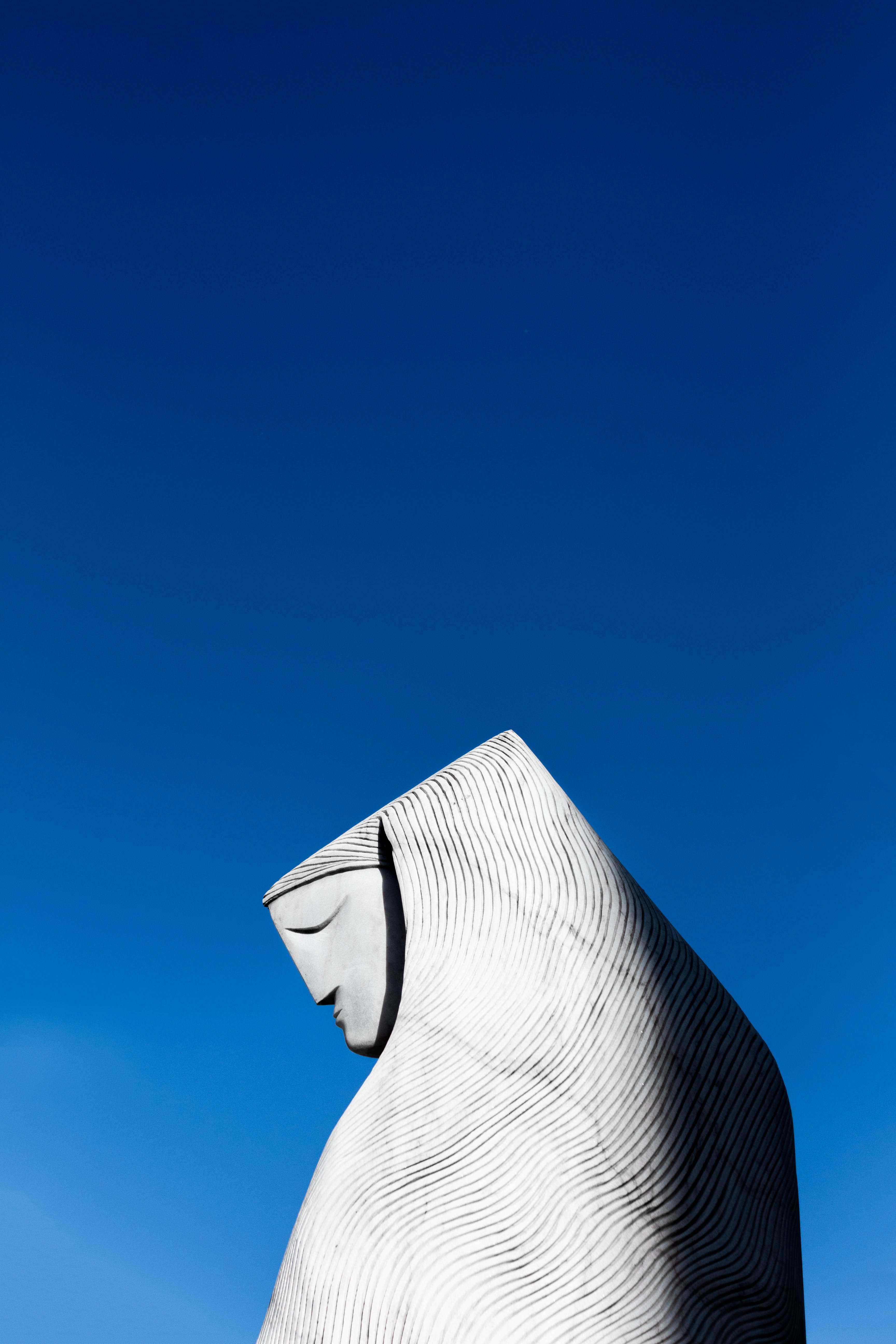 Low Angle Photography of Gray Statue