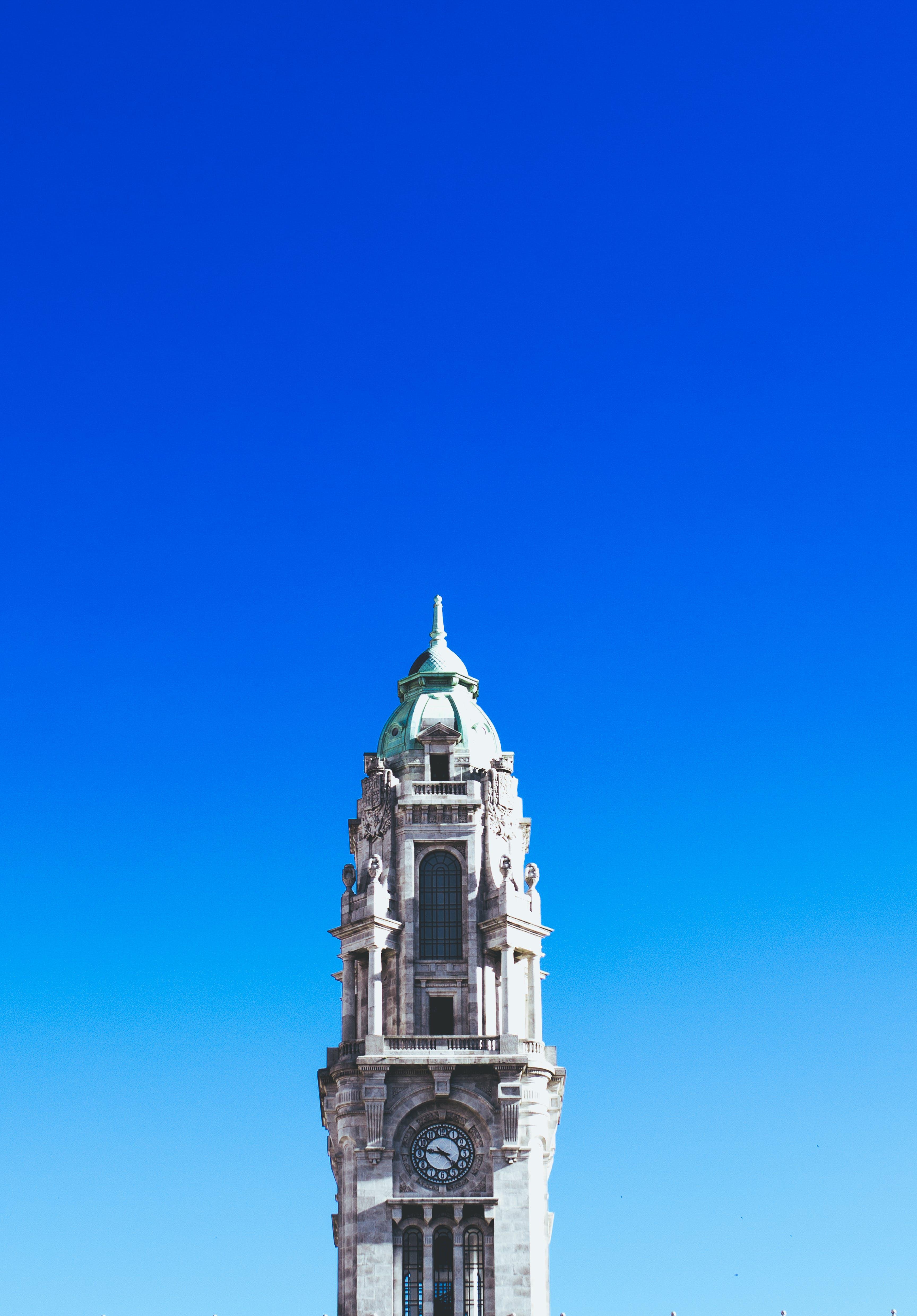 Gray Concrete Clock Tower Under Blue Sky