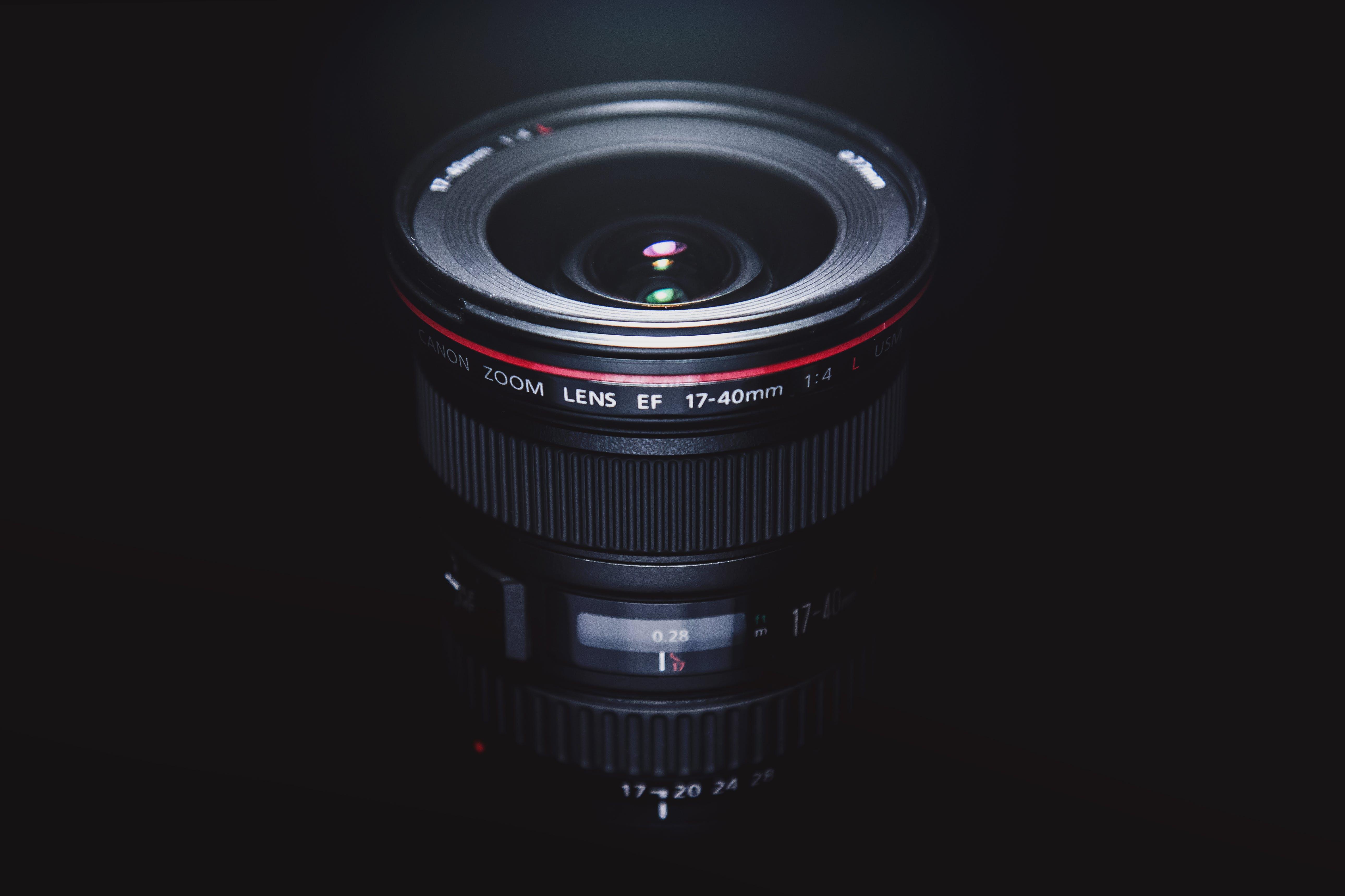 Black Ef 17-40mm Camera Lens in Dark Surface