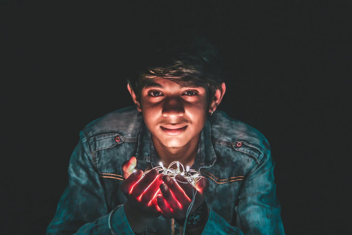 Man Holding White String Light Photo