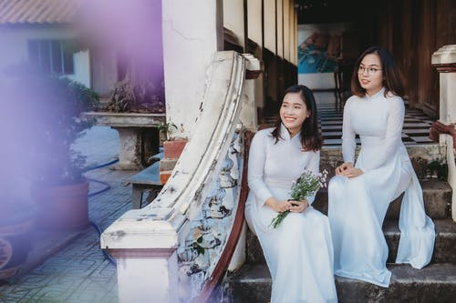Woman in White Wedding Dress Standing Beside Woman in White Wedding Dress
