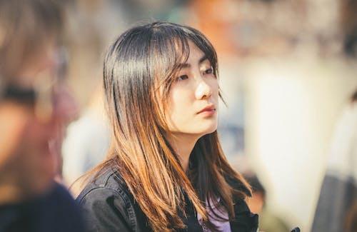 Woman in Black Jacket Looking Down