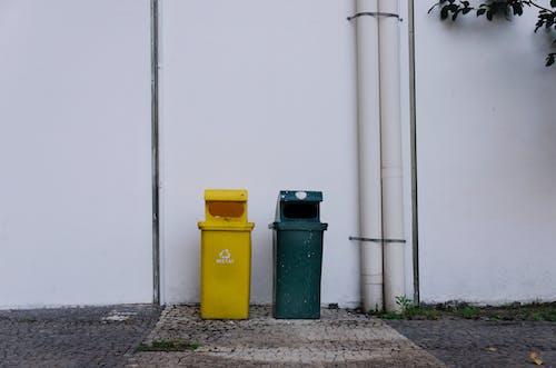 Green Trash Bin Beside White Wall
