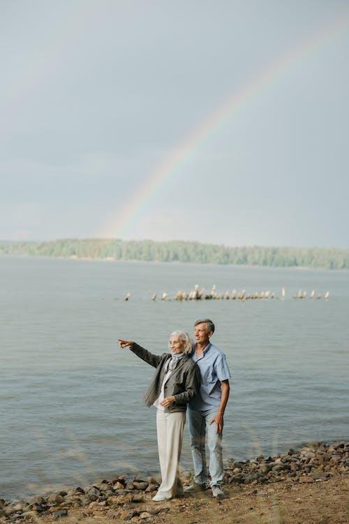 Безкоштовне стокове фото на тему «берег моря, блакитне небо, Веселка»