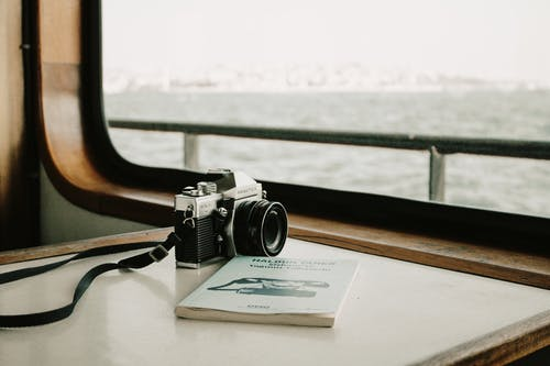 Black and Silver Dslr Camera on White Paper
