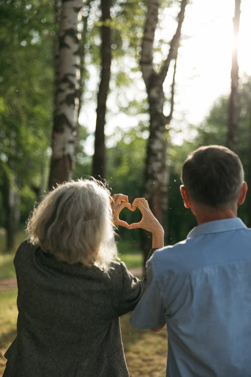 Man and Woman Sightseeing on the Park