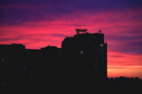 Free stock photo of city sunset, dark building, evening sky
